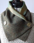 Irish Tweed cross over scarf with front button fastening.